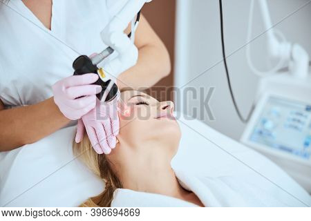 Young Woman Undergoing A Non-invasive Cosmetic Procedure