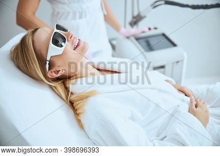 Cheerful Woman Client Anticipating A Beauty Procedure