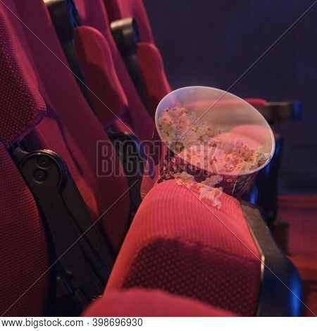 Abandoned Popcorn On A Chair In The Cinema Hall. Problems With Bankruptcy Of Movie Theaters And Conc
