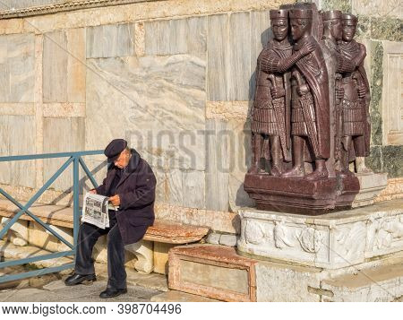 Venice, Veneto, Italy - November 23, 2016: An Elderly Man Is Reading His Newspaper On A Quiet Sunny