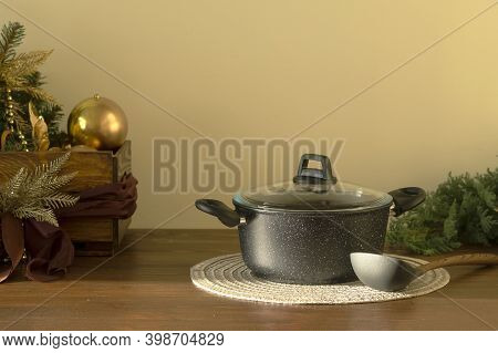 Casserole With A Christmas Dish, Soup, Stew, Casserole On The Festive Table. Christmas Toys In The B