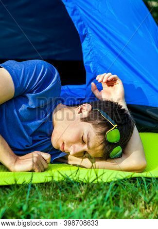 Man Sleep Near The Tent On The Nature