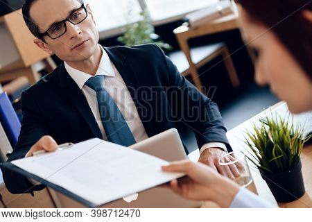 Lawyer Gives Documents To A Woman To Sign A Divorce. A Woman Came To A Lawyer In The Office To Sign