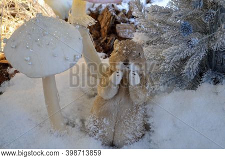 Shop Window Decoration, Shopping Center Decor. Artificial White Spruce With Garlands. Next To Them,