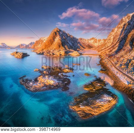 Aerial View Of Beautiful Mountains, Small Islands In The Sea, Road, Blue Sky At Sunset In Lofoten Is