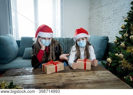 Sad Children With Face Mask Bored At Home Alone At Christmas Missing Family And Friends