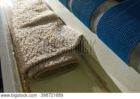Dirty Carpet Soaking In Special Chemical Solution In Carpet Cleaning Service