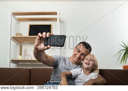 Dad And Son Take Pictures Of Themselves And Laugh. Paternity