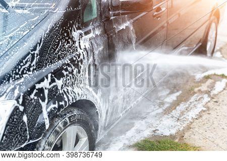 Mini Bus Van Car Wash With High Pressure Water Equipment Pump At Home Backyard Outdoors On Bright Sh