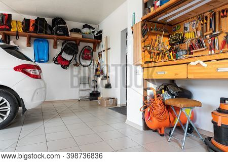 Home Suburban Car Garage Interior With Wooden Shelf, Tools Equipment Stuff Storage Warehouse On Whit