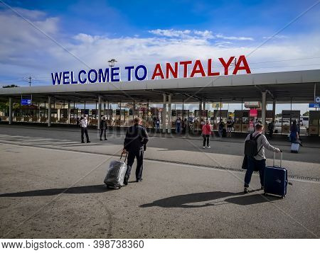 Antalya, Turkey - October 21, 2020: Large Signboard Welcome To Antalya At Airport. Tourists With Sui