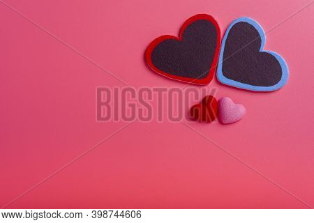 Two Hearts On A Pink Background In The Upper Right Corner And Two Small Hearts. The Concept Of Valen