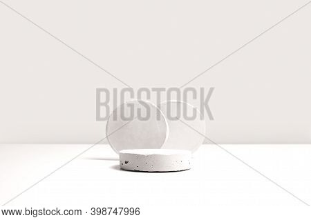 Gray Cocncrete Circle Shaped Pedestals On White Table With Copy Space, Side View. Podium Mockup Back