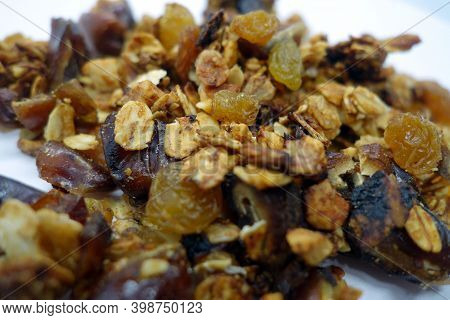Tasty Granola On White With Blur Effect. Food And Ingredients Background.