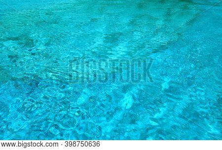 Swimming Pool Water Surface. Texture And Background