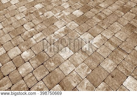 Stone Pavement Surface In Brown Tone. Abstract Background And Texture For Design.