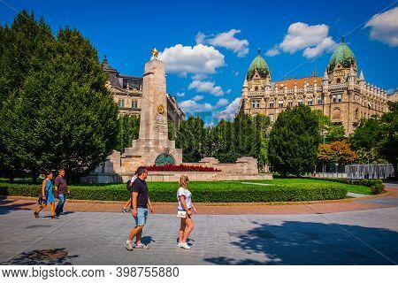 Budapest, Hungary, Aug 2019, Tourists Walking By The Monument To The Soviet Soldiers For The Liberat