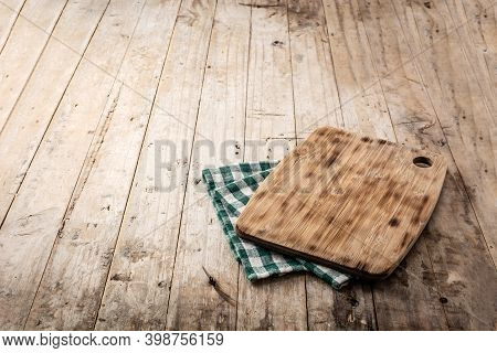 Cutting Board Mockup And Green Tablecloth On Wooden Table. Copy Space