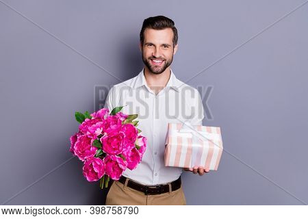 Portrait Of His He Nice Attractive Elegant Classy Cheerful Cheery Man Holding In Hands Bunch Flowers
