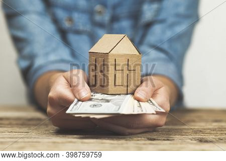 Money And A House In Hand. Pledge For Real Estate, Rental Income. Home Sales Taxes.