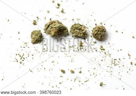 Cannabis Branch And Joint Isolated In A White Background. Marijuana Legalization. Medical Cannabis.