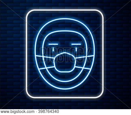 Glowing Neon Line Doctor Pathologist Icon Isolated On Brick Wall Background. Vector