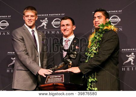 NEW YORK-DEC 8: (L to R) Collin Klein, Johnny Manziel and Manti Te'o attend the 2012 Heisman finalists press conference at the Marriott Marquis on December 8, 2012 in New York City.