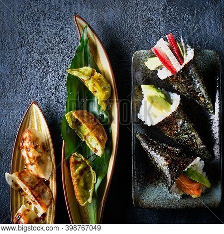 Set Of Japanese Sushi Background Chinese Dumpling Gyoza Jiaozi, Temaki With Salmon, Tuna, Shrimp, Av