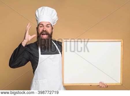 Chef. Empty Menu. Copy Space For Text. Male Chef, Cook Or Baker With Blank Board. Man Cook Showing E