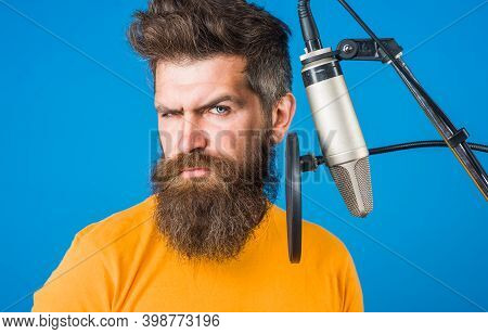 Singing. Bearded Man In Karaoke. Man Singing With A Microphones. Microphone. Sings A Song Into A Mic