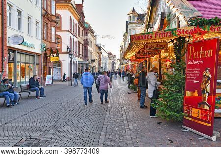 Heidelberg, Germany - December 2020: People Wearing Face Masks Buying Food And Drinks At Festive Dec
