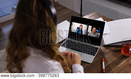 Young Business Woman At Home Office Attends A Video Conference During The Corona Covid-19 Pandemic