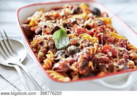 Baked Fusilli Pasta With Cherry Tomatoes, Olives And Mozzarella Cheese. Bright Wooden Background. Cl