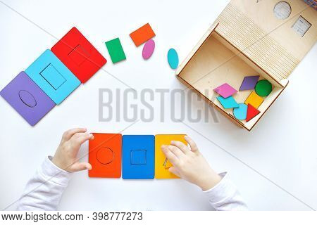 Learning Colors And Shapes. Childrens Wooden Toy. The Child Collects A Sorter. Educational Logic Toy