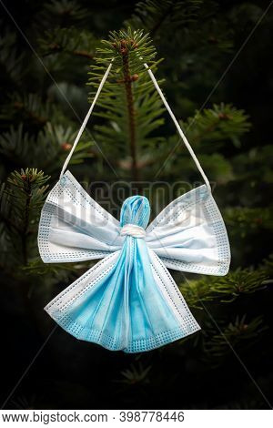 A Christmas Angel decoration made from recycled medical masks. This shows the uniqueness of 2020 and is a tribute to thank all the medical Angels who have cared for Covid patients around the world.
