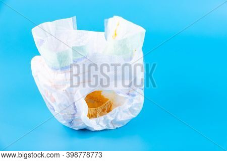 Feces Of A Newborn Baby, One Month From Birth In A Diaper On A Blue Background.