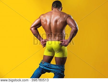Gay Panties Down. Naked Mens Back And Shoulders On Isolated On Yellow. Metrosexual Concept. Shirtles