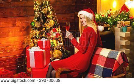Woman Elegant Girl Red Dress Celebrate Christmas. Girl Near Christmas Tree Winter Decorations Interi