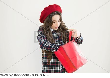 Just A Minute Of Surprise. Little Girl Looking For Surprise Gift On Yellow Background. Small Child H