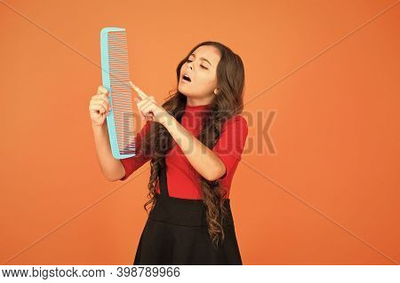 Give Your Hair A Comb. Small Child Touch Comb Tooth Brown Background. Plastic Hair Comb. Combing Too