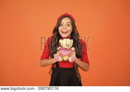 Got Her Surprise Present. Happy Girl Hold Teddy Bear Brown Background. Present For Valentines Day. C