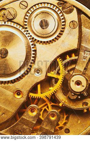 Close-up Of Old Clock Watch Mechanism. Retro Clockwork Watch With Golden Gearwheels Gears. Vintage M