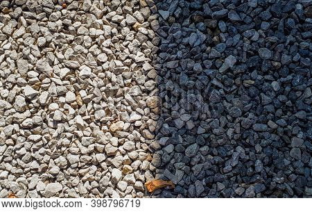 Difference Concept. Half Gravel Is In Sun And Half Is Shadow. Gravel Texture