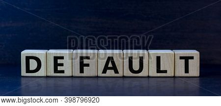 Default Symbol. Concept Word 'default' On Wooden Cubes On A Beautiful Dark Wooden Background. Wooden