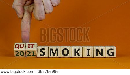 Quit Smoking 2021 New Years Resolution. Male Hand Flips Wooden Cubes With Words '2021 Quit Smoking'.