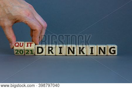 Quit Drinking 2021 New Years Resolution. Male Hand Flips Wooden Cubes With Words '2021 Quit Drinking