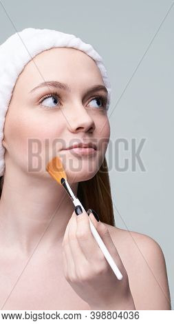 Young Pretty Woman Studio Portrait. Cosmetology Concept. Esthetic Woman Face. Skin Care Dermatology.