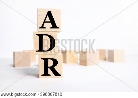 Adr Adverse Drug Reaction. Text On Wood Cubes On White Background
