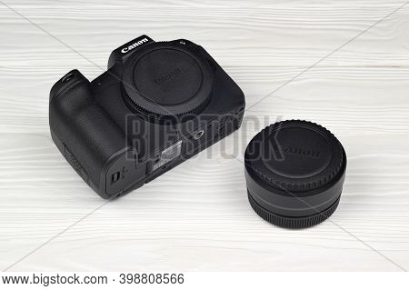 Canon Eos R Photocamera And Mount Adapter Ef - Eos R On White Wooden Table. Photography Equipment By