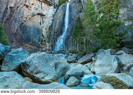 Scenic Shot Of Yosemite Falls Waterfall In Yosemite National Park. High Quality Photo